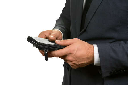 intrigued: Man holding his wallet. Solving problem with single touch. Wealth in a case. A pleasant thing to have. Stock Photo