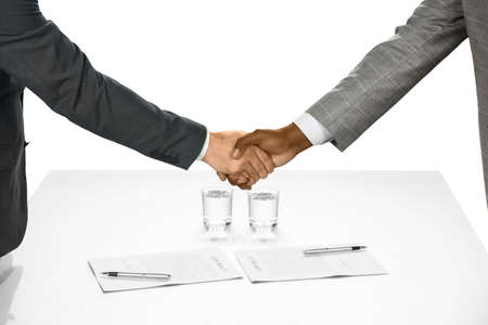 Businesspeople shake hands. The contract is signed. Welcome to the team. Starting a partnership.