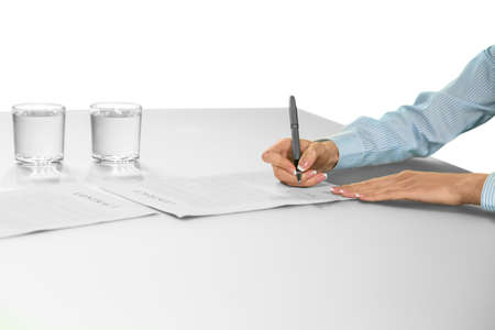 careful: Businesswoman signing contract. The decision is made. A careful choice. Building a big company.