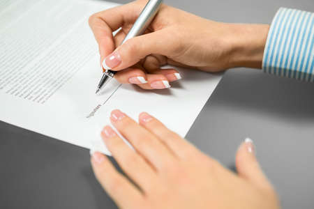 understood: Woman puts a signature. The last signature needed. Read and sign. Everything is understood.