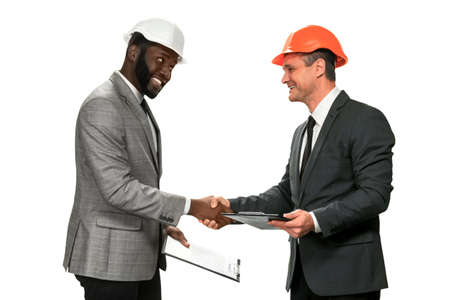 Black construction manager is satisfied. Good news from construction sight. This project is ready. Thanks for coopeartion. Stock Photo