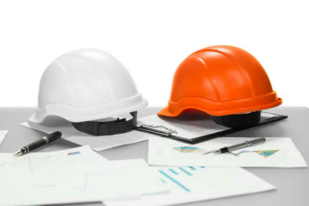 familiar: Construction helments and documents. Manager has already left. Put this on for safety. Getting familiar with project.