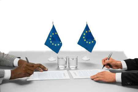 politicians: Politicians of european union working. Documents of unbelievable value. Completion of summit. Two sides of an agreement.
