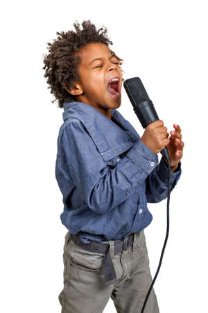 emotionally: Boy singer emotionally performs the difficult song .