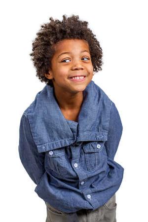 funny boy: Little schoolboy slyly spy. Leer. Sly eyes. Stock Photo
