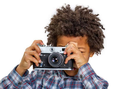 Little photographer learns to shoot reportage. Pretty boy. Stock Photo - 53049693