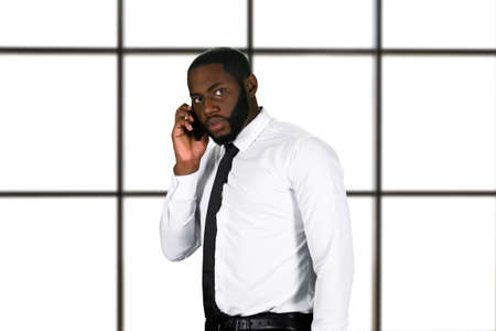 phonecall: Anxious chief on the phone. Stressful phonetalk in business center. Dark thoughts and fear. Disturbing phonecall in penthouse.
