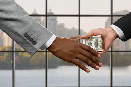 criminal case: Businessmen passing cash at daytime.