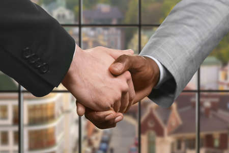 realtionship: Businessman shake hands in headquarters.
