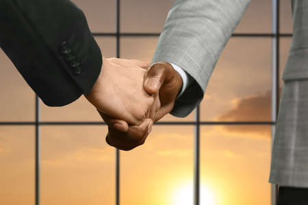 realtionship: Business meeting handshake at sunset.