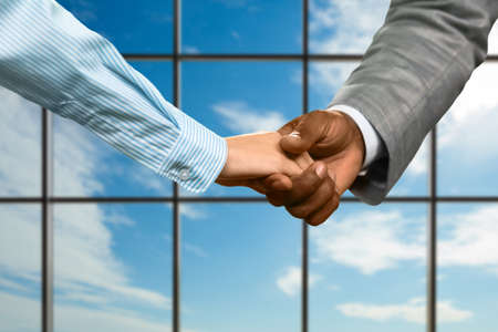 realtionship: Business couples handshake at daytime. Office manager shaking womans hand. Pleasant meeting of partners. Sign of respect.