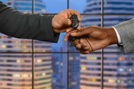 achievment: Office managers pass car key.