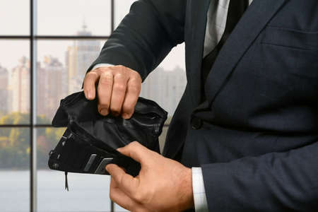 empty wallet: Office employee with empty wallet. Stock Photo