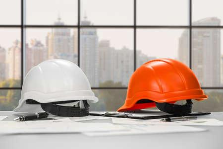 inspectors: Safety inspectors helmets on office desk.