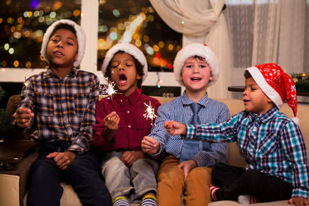 Kids singing Christmas song. Four children sing Christmas song. Shall we sing. Gentlemen respect traditions.