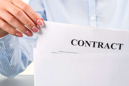 chances: Womans hand taking contract letter. Female hand takes contract letter. Definitely good news. I have good chances.