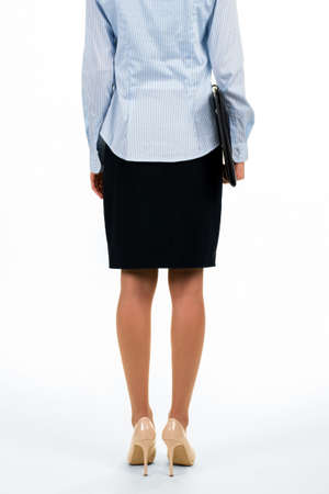 to move forward: Standing woman with a folder. Back view of young businesswoman. Time to move forward. On the road to wealth. Stock Photo