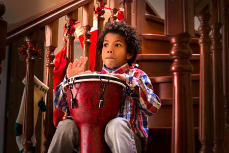 guess: Scared black kid with drum. Young drum player is scared. I guess it was loud. Better to make short break.