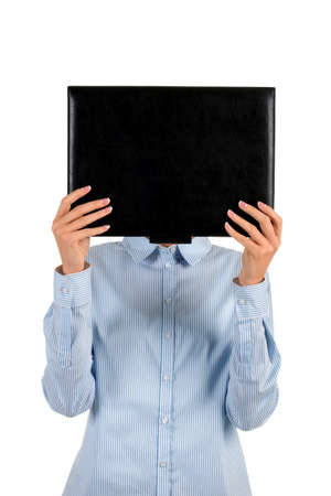 face covered: Lady covers face with folder. Businesswomans face covered with folder. Unidentified female criminal. Subject of investigation.