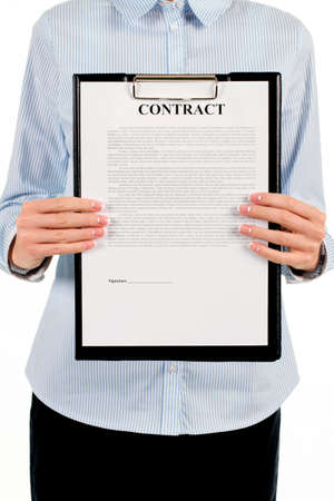 stated: Woman holding clipboard with contract. Businesswoman showing contract on clipboard. Please read this document through. Our conditions are stated here. Stock Photo