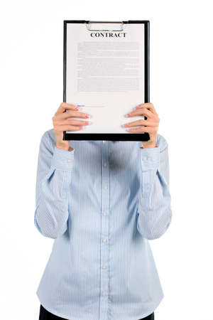 face covered: Woman covering face with clipboard. Businesswomans face covered by clipboard. Concentrate and look closely. It there someone behind it. Stock Photo