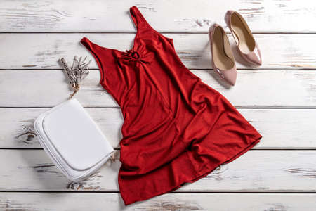 neckline: Keyhole neckline dress and shoes. Luxury outfit on display. At the fashion house. New collection in outlet shop.