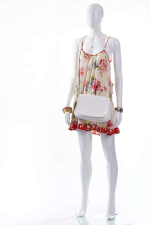 gold flax: Sarafan with accessories on mannequin. Female mannequin wearing summer outfit. Different accessories and sarafan. Ladys summer outfit with handbag. Stock Photo