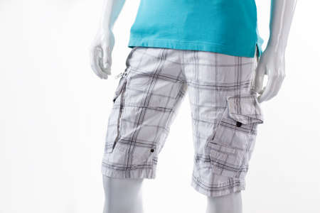 male mannequin: White checkered shorts on mannequin. Male mannequin in cargo shorts. Mens shorts with pockets. Light cotton summer shorts.