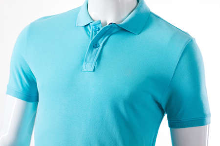 male mannequin: Light blue t-shirt on mannequin. Male mannequin in polo t-shirt. Casual light garment for men. T-shirt sale at local store.