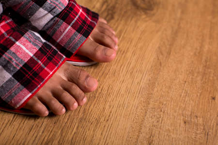 dont walk: Afro kids feet in slippers. Close-up of feet in slippers. Dont walk barefoot. Comfort and ease.