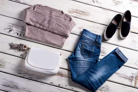 womans clothing: Sweater and slip-on shoes. Female autumn outfit on display. Clothing for young stylish women. Selection of womans spring clothes.