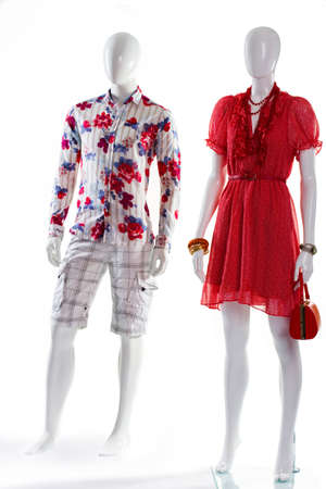woman's clothing: Dress and shirt on mannequins. Mannequins in bright summer clothing. Mens shirt and womans dress. V-neck dress and floral shirt.