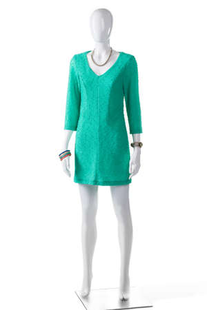 sleeve: Casual turquoise dress on mannequin. Female mannequin in turquoise dress. Ladys bright-colored casual clothing. Long sleeve summer garment.