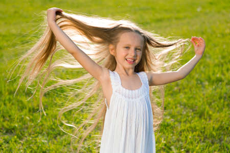 Little girl with long flowing hair. Beautiful child.