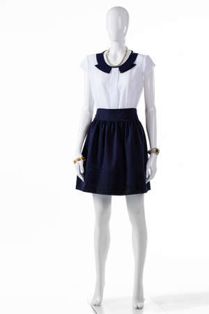 short sleeve: Short sleeve blouse on mannequin. Skirt with short sleeve blouse. Ladys light top and skirt. Womans bicolor evening outfit. Stock Photo