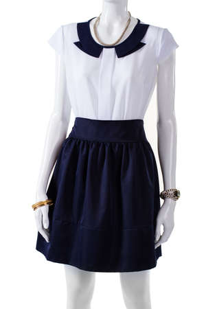 short sleeve: Mannequin wearing short sleeve blouse. White blouse with navy collar. Elegant blouse and wrist accessories. Ladys light top and watch. Stock Photo