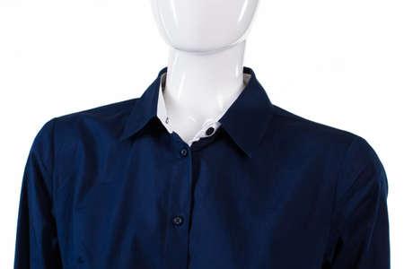 formal shirt: Navy formal shirt on mannequin. Ladys plain formal shirt. Dark shirt with unbuttoned collar. Navy official shirt on display.