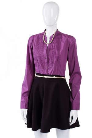 sleeve: Dark skirt with purple shirt. Purple shirt on female mannequin. Trendy shirt with stand collar. New fashionable long sleeve shirt. Stock Photo
