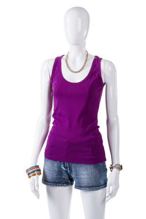 woman's clothing: Female mannequin in purple top. Womans purple cotton tank top. Simple comfortable clothing on display. Sale of trendy summer apparel.