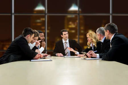 too much work: People in suits having discussion. Working collective at late hours. They have too much work. Problem has to be solved. Stock Photo