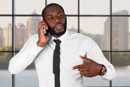 diplomacy: Darkskinned man on the phone. Managers phonetalk in the city. Diplomacy is priceless. Honest and trustworthy leader. Stock Photo