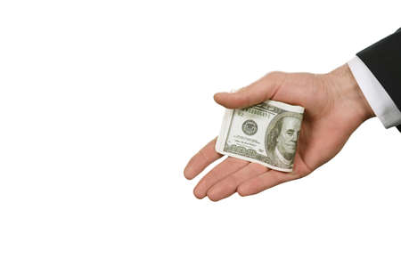 solve problems: Caucasian businessmans hand with money. American dollars on white background. Origin of crime. Easy way to solve problems.