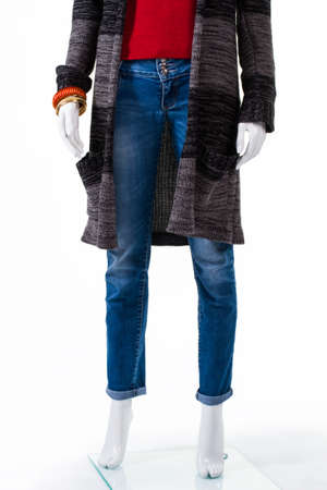 outerwear: Striped sweater coat and jeans. Mannequin wearing long sweater coat. Girls autumn outerwear on sale. Coat made of soft fabric.
