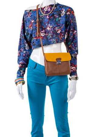 womans clothing: Crop top with bicolor handbag. Bicolor leather purse on mannequin. Trendy crop top and accessories. Selection of womans summer clothing.
