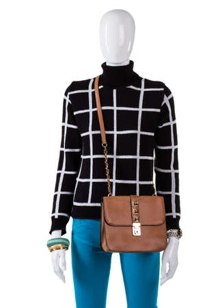 low prices: Checkered sweatshirt and leather purse. Female mannequin wearing brown bag. Girls stylish handbag on display. Low prices for autumn collection.