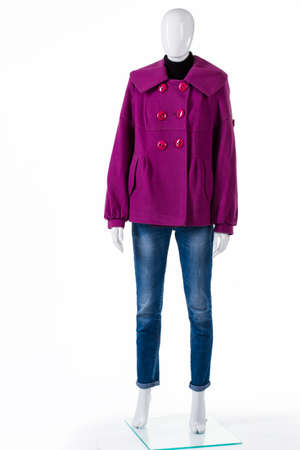 outerwear: Purple coat with blue jeans. Mannequin wearing jeans and coat. Fleece outerwear for autumn. Ladys new coat on display.