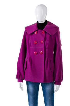 outerwear: Purple coat and simple jeans. Female mannequin wearing purple coat. Warm stylish outerwear for women. Fleece garment at low price. Stock Photo