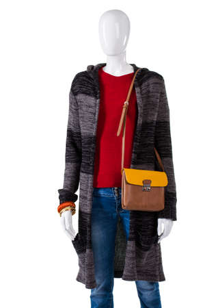 outlet store: Leather handbag and sweater coat. Outerwear and purse on mannequin. Best choice in outlet store. Nice discount for ladys apparel. Stock Photo