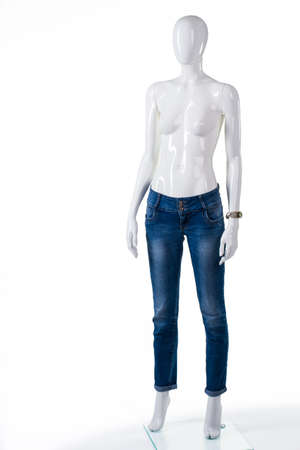skinny jeans: Plain blue skinny jeans. Female mannequin in skinny jeans. Jeans sale in outlet shop. Pants of high-quality material.