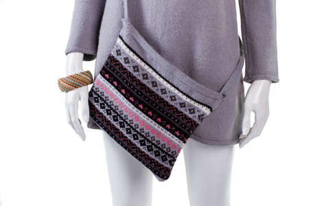 tunic: Warm top, purse and bracelet. Tunic and bracelet on mannequin. Ladys warm high-quality clothes. Trendy pattern bag on sale.